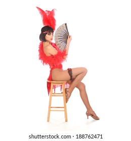 Burlesque dancer with red plumage and red short dress, isolated on white