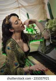 Burlesque girl play an old piano with closed eyes and green lights background