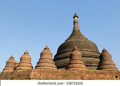 Burma, Mrauk U temples. Ratanabon Paya (stupa) - this massive stupa is ringed by 24 smaller stupas. It was apparently built by Queen Shin Htway in 1612.