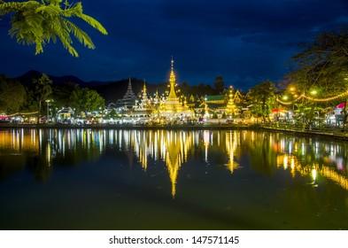Burmese Architectural Style of Wat Chong Klang (r) and Wat Chong Kham (l) at dusk. Mae Hong Son, Northern Thailand