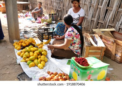 Burmese vendor sale products raw material food fruits vegetables for burma people and foreign travelers select buy in local market bazaar at Bagan or Pagan city on June 2, 2015 in Mandalay, Myanmar