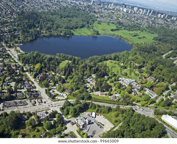Burnaby Aerial - Deer Lake Park with lake and homes in Burnaby
