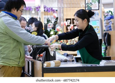 Burnaby, BC, Canada - April 03, 2017 : People signing name for paying credit card to buy foods at check out counter inside T&T supermarket