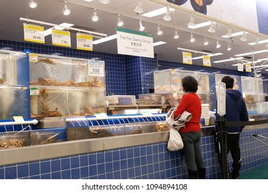 Burnaby, BC, Canada - April 09, 2018 : Motion of people buying fish at seafood section inside T&T supermarket