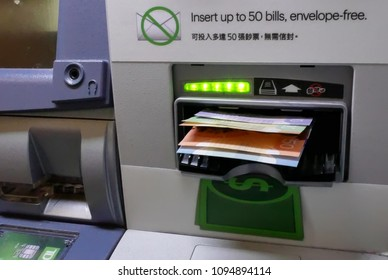 Burnaby, BC, Canada - April 09, 2018 : Motion of people withdrawing money of ATM machine inside TD bank