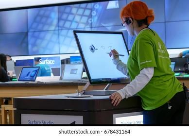 Burnaby, BC, Canada - March 07, 2017 : Clerk painting on new computer at Microsoft store in Burnaby BC Canada