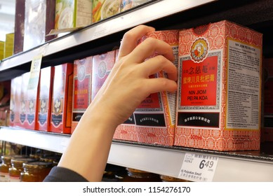 Burnaby, BC, Canada - May 30, 2018 : Motion of woman buying chinese medicine inside price smart foods store