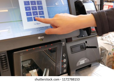 Burnaby, BC, Canada - May 30, 2018 : Motion of woman paying foods at self-check out counter inside Price smart food store