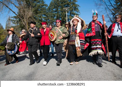 Burnaby, BC/Canada - March 10 2018: Kwekwecnewtxw Protect The Inlet March against the Trans Mountain expansion pipeline previously owned by Kinder Morgan and now owned by the Canadian government.