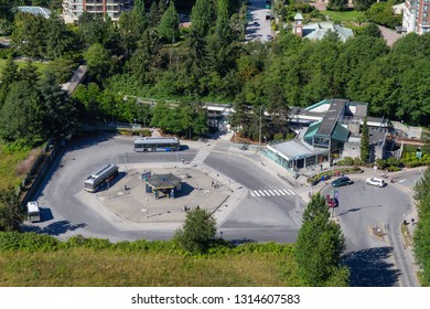 Burnaby, Greater Vancouver, BC, Canada -  July 4, 2018: Aerial view of a skytrain station and a bus loop during a sunny summer day.