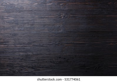 Burned black wooden texture background surface copy space for design