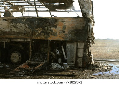 Burned bus. set fire to the cars in the parking lot. Bandit wars, a bus destroyed by fire after the Molotov cocktail. A fire-deformed machine. Consequences of a car accident, Donbass, Ukraine, 2014