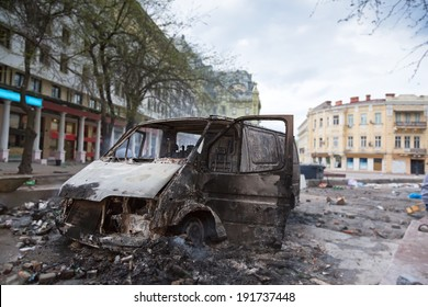 Burned car in the center of city after unrest in Odesa, Ukraine