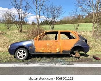 Burned car at the road
