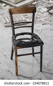 Burned chair in an old building