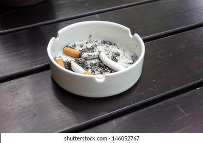 burned cigarettes in ashtray