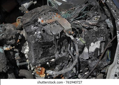 Burned and damaged car battery after fire accident