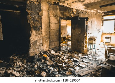 Burned house interior after fire, ruined building room inside, disaster or war aftermath concept, toned