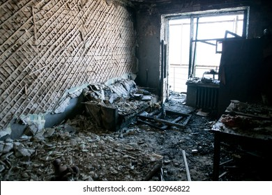 Burned interiors of industrial or residential building. Fire consequences concept.
