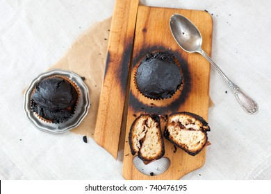 burned muffins - black cupcakes, failed baking, catastrophe in the kitchen, burned on charcoal