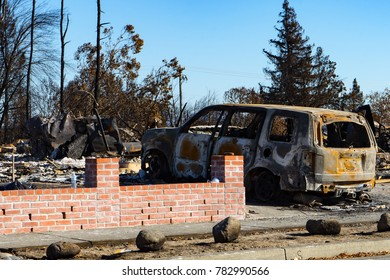 Burned neighborhood with minivan, California wildfires