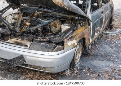 Burned ola car. set fire to cars in parking lot. Deformed fire machine. Consequences of car accident. Damaged by arson. The explosion of gas in the tank machine. Car insurance and health.