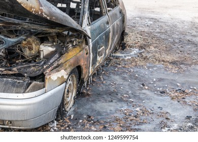 Burned ola car. set fire to cars in parking lot. Deformed fire machine. Consequences of car accident. Damaged by arson. The explosion of gas in the tank machine. Full car accident insurance.
