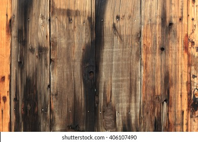 Burned old barn wood wall background.