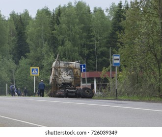 Burned truck at the road side