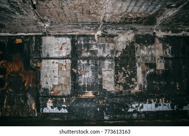 Burned underground pedestrian crossing after a fire or terrorist attack, walls in soot and smoke, dark toned