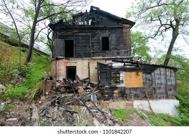 The burned-down abandoned barrack.