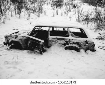 Burned-out car in field, Moscow region