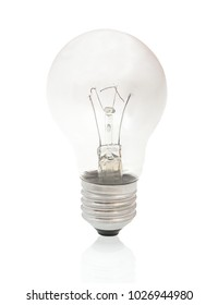 Burned-out light bulb isolated on white background with shadow reflection. Burned light bulb on white backdrop. Burned incandescent light bulb.