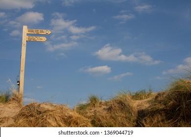 Burnham Overy Staithe, Norfolk/UK - September 2nd 2018:  Signpost at Gun Hill. landscape orientation