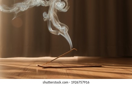 Burning aromatic incense smoky stick for meditation and relaxing. Aromatherapy smoke for yoga concept.