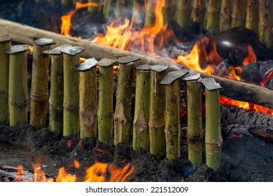 Burning bamboo rice in traditional cooking