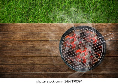 Burning barbecue on grass background
