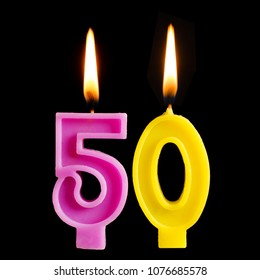 Burning birthday candle in the form of 50 fifty figures for cake isolated on black background. The concept of celebrating a birthday, anniversary, important date, holiday, table setting
