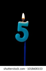 Burning Birthday Candle Isolated On Black Background Number 5