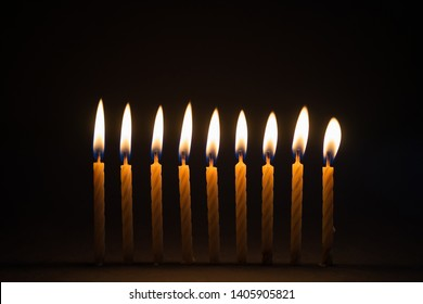 Burning birthday candles with black background
