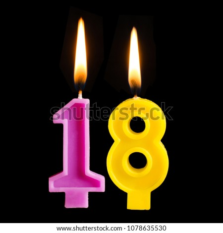 Burning Birthday Candles In The Form Of 18 Eighteen Figures Or Cake Isolated On Black Background