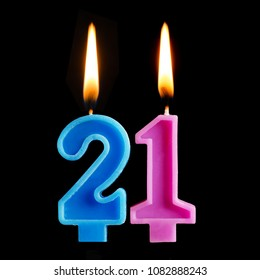 Burning Birthday Candles In The Form Of 21 Twenty One For Cake Isolated On Black Background