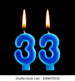 Burning Birthday Candles In The Form Of 33 Thirty Three For Cake Isolated On Black Background