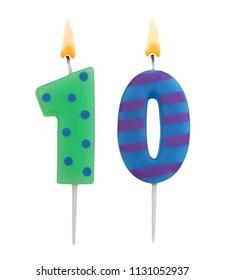 Burning birthday candles isolated on white background, number 10