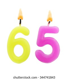 Burning Birthday Candles Isolated On White Background Number 65