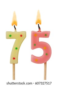 Burning birthday candles isolated on white background, number 75
