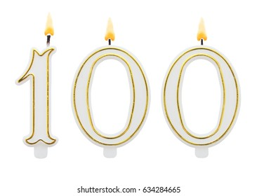 Burning birthday candles isolated on white background, number 100