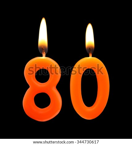 Burning Birthday Candles On Black Number 80