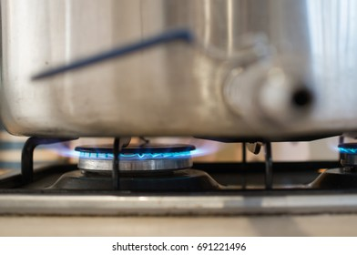 Burning blue gas on the kitchen stove