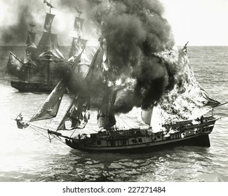 Burning boat in the middle of the ocean